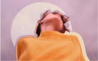 Woman in yellow sweater